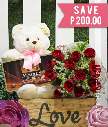 1 Dozen Red Roses with Bear and Vochelle Almond Heart Box Chocolate