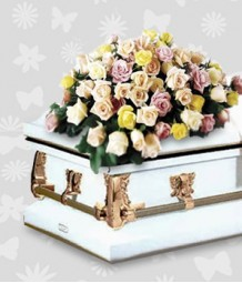 Mixed roses in a casket